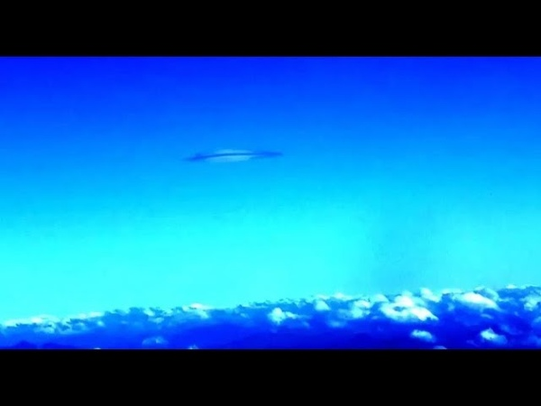 Saucer Shaped Object Captured Hovering Above The Clouds During Flight From Amsterdam to China