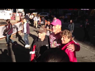 WWE John Cena posing with fans in Times Square in New York