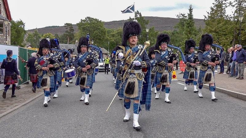RAF Central Scotland Pipes Drums parade through village to 2018 Braemar Gathering Highland Games