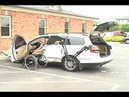 Robot 2001 arm putting wheelchair into VW passat