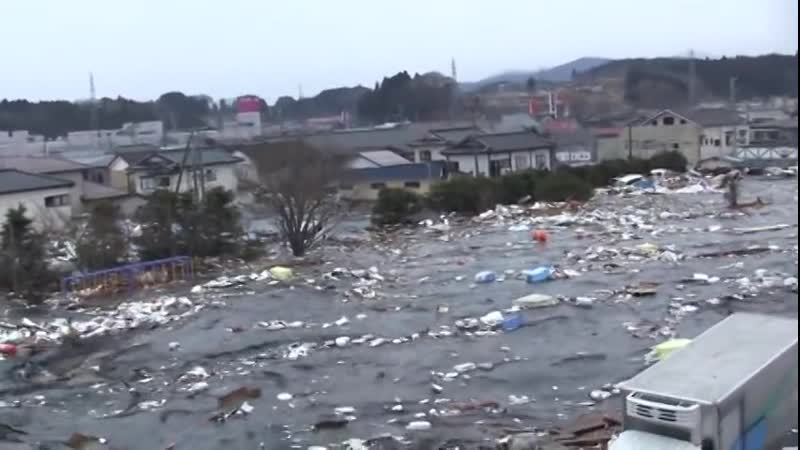 Tsunami in Kesennuma city, ascending the Okawa riv