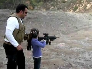 8 year old girl shooting  the AR-15