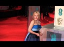 Gillian Anderson has a bit of a trip at the Bafta's in London