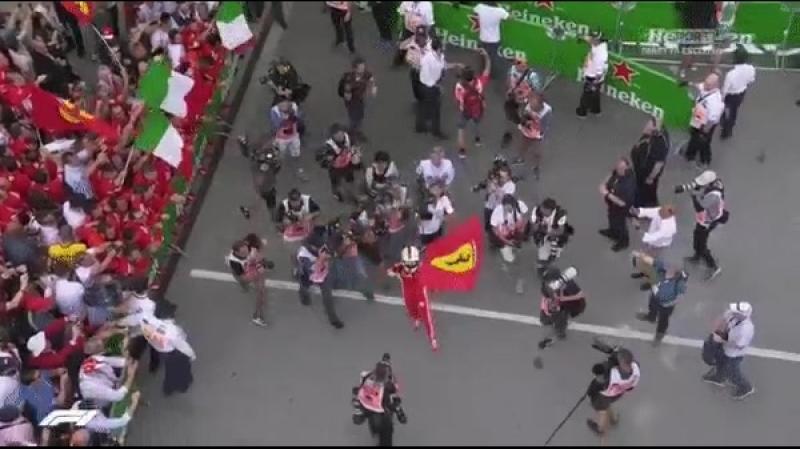Seb waves the Ferrari flag in Parc Fermé