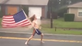 Real American with American flag in hand Vs Hurricane.- Music by Armcannon