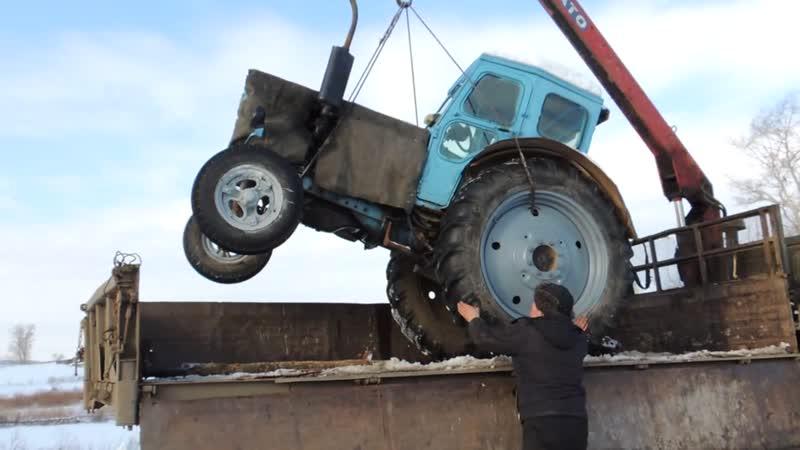 Услуги манипулятора в Уфе, погрузка трактора
