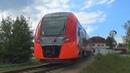 Электропоезд ЭС2Г-087 Ласточка с 2-я грузовыми вагонами и тепловозом толкачём ЧМЭ3-6036