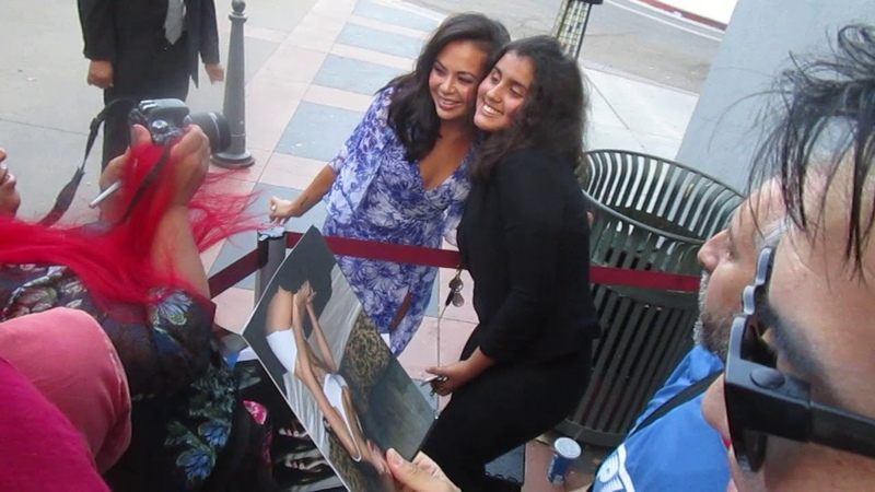 Janel Parrish greets fans signs autographs at To All The Boys Ive Loved Before premiere