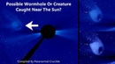 Possible Wormhole Or Alien Ship Caught Near The Sun?