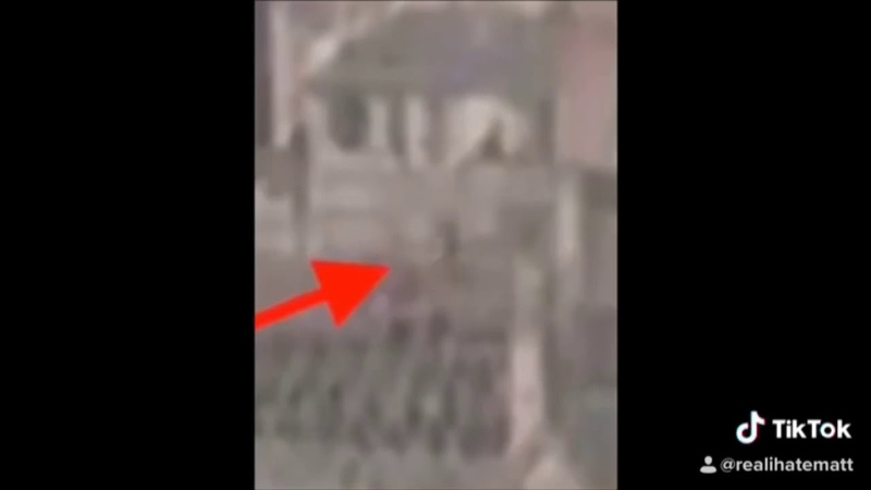 Webcam footage shows figure in cathedral prior to fire and a bright flash