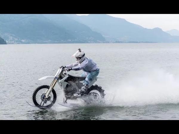 Daredevil Rides a Motorbike Across Italys Third Largest Lake