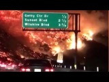 Commuter drives through raging wildfire in California dashcam video