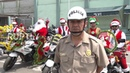 Christmassy cops cruise through Lima to reinforce rules of the road