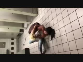 Two girls fight