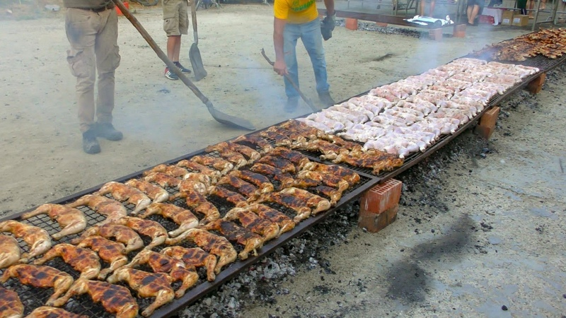 Tons of Chicken Roasted and Cooked in a Huge and Long grill. Italian Street Food