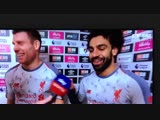 Mo Salah handing over his MOTM award to Milner to commemorate his 500th PL appearance.