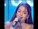 Juhi Chawla at the Zee Awards 2004 singing a song from the film Kal Ho Naa Ho