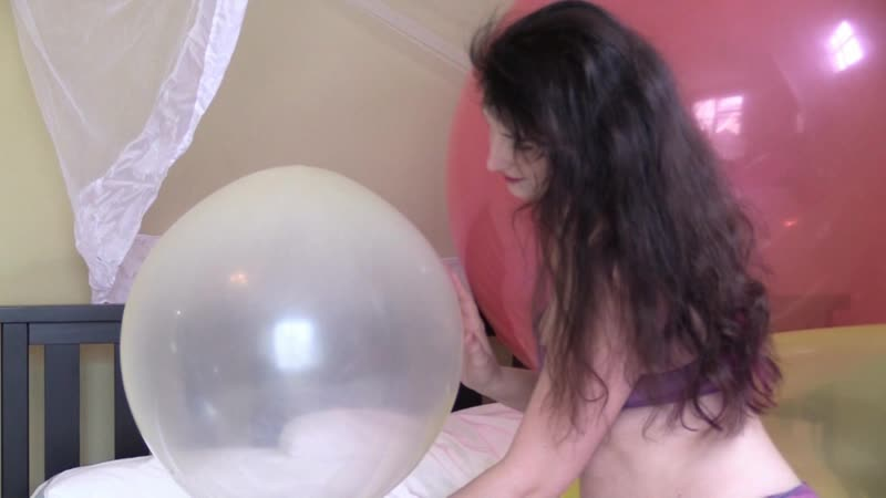 Paige Erin Turner inflating a balloon on set