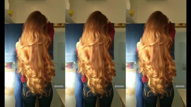 Very long hair the color of wheat beautiful girl