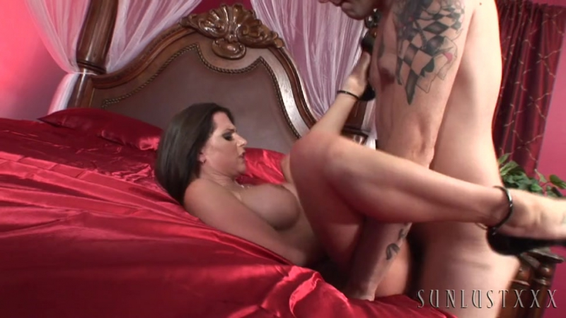 Girl on girl sex on a set of soft satin sheets