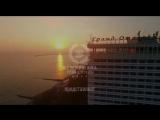 Реклама на медиа-фасаде Гранд отеля Жемчужина