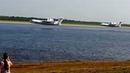 Забор воды на реке Обь пожарными самолетами БЕ-200. Улетное видео.