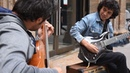 Acoustic Guitar Electric Guitar improvises a beautiful melody in the street