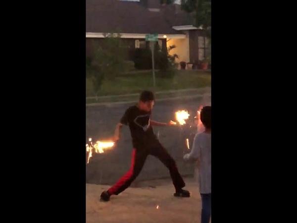 Kid dancing with sparkler fireworks