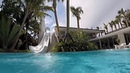 Waterfront Luxury House Pool with gigantic water slide basketball court on the roof in Miami Beach