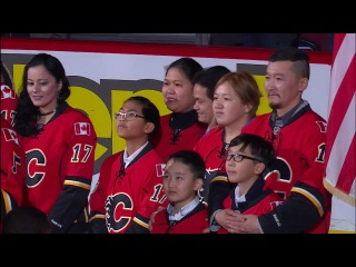 New Canadians sing anthem appropriately at hockey game