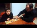 С Ариэлем играем в игру Манкала