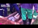 (HD) Brazilian buried alive, and pulled from the grave