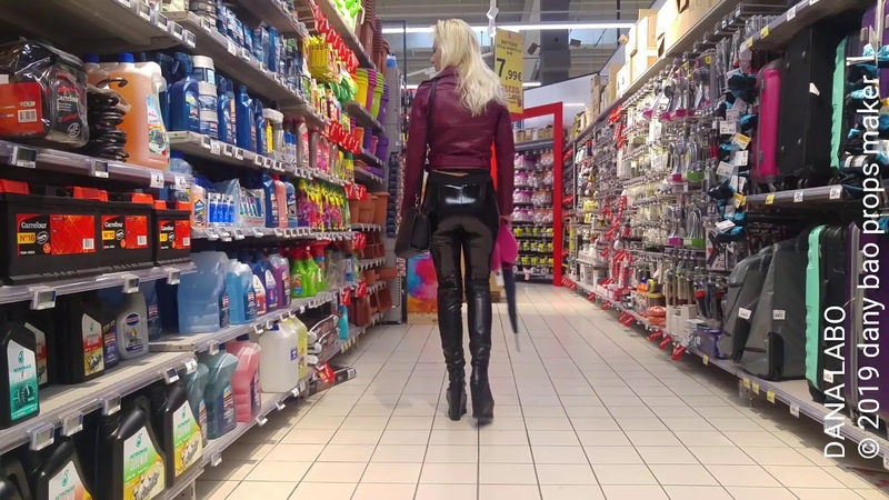 DANA LABO shopping in shiny leggings and wedge boots