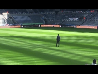 Unai emery deep in thought, taking his first look at st james park, followed by lichtstein