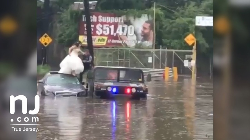 Bride and groom rescued by police from rising flood waters