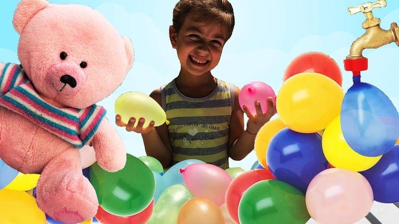 Игра Челлендж Водяные бомбочки! Играем с Эмилюшей шариками с водой! Надувные шарики капитошки