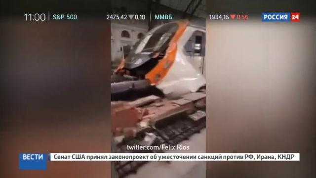 Новости на Россия 24 • Появилось видео искореженного вагона электрички, попавшей в аварию в Барселоне