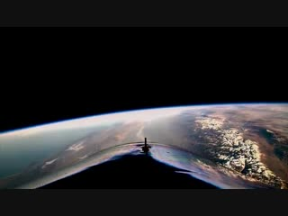 New footage from virgin galactic's historic flight last week in this video