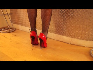 Cuffed in High Heels with 17 cm Heel and net Stockings at the Wall