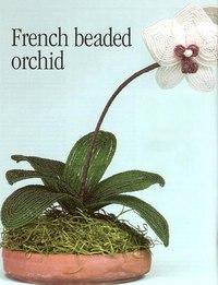 Белая орхидея Ход работы: Прекрасная белая орхидея, сплетенная из бисера.  Отлично украсит интерьер вашей комнаты.