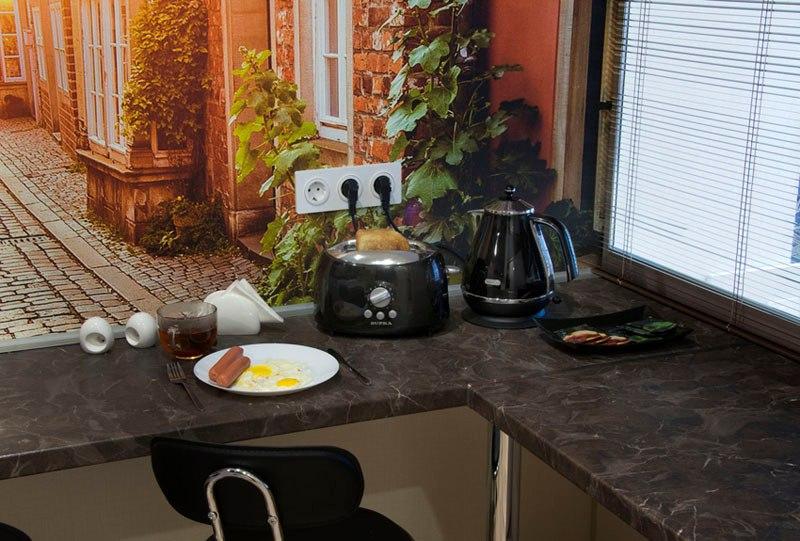 Идея по отделению кухни в небольшой студии.