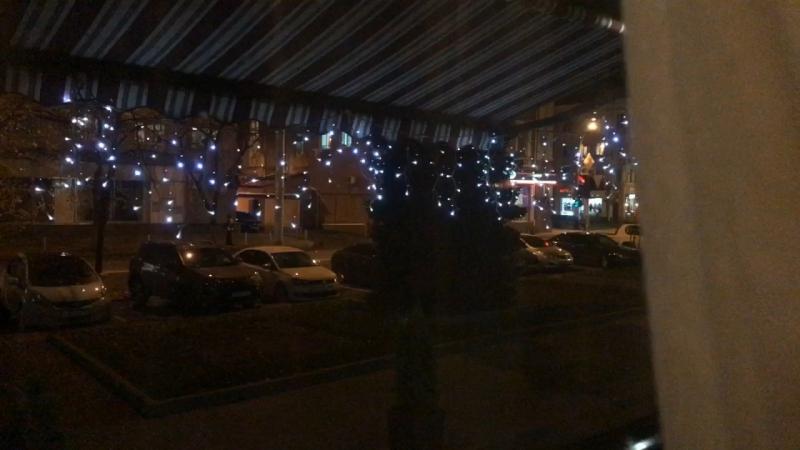 Вид на вечерний город из окон VinSent Cafe