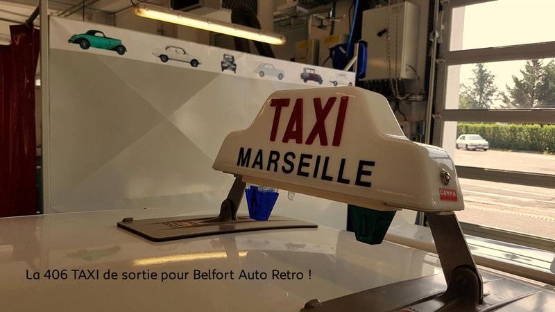 Montage de l'expo L'Aventure Peugeot fait son cinéma !