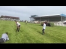 Lads have a foot race at Navan Racecourse, Ireland