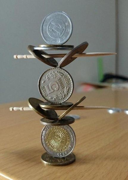 Япoнец создаёт невероятные скульптуры из монет, бросающие вызов законам физики.