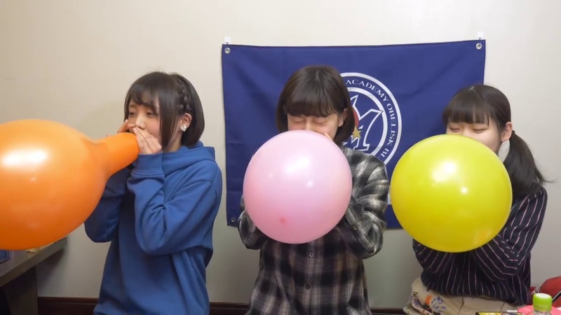 Cute japanese girls blow to pop balloon and stab the other with a knife