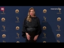 Yvonne Strahovski shows her baby bump on the Emmys red carpet