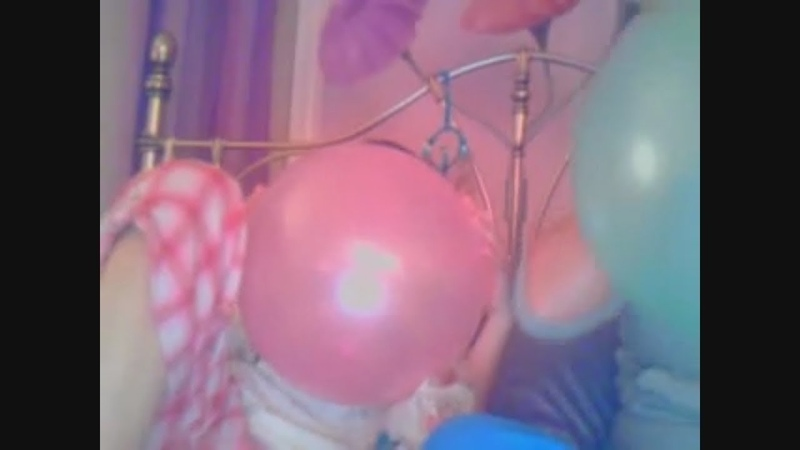 Girls blow up balloons and pop them funny