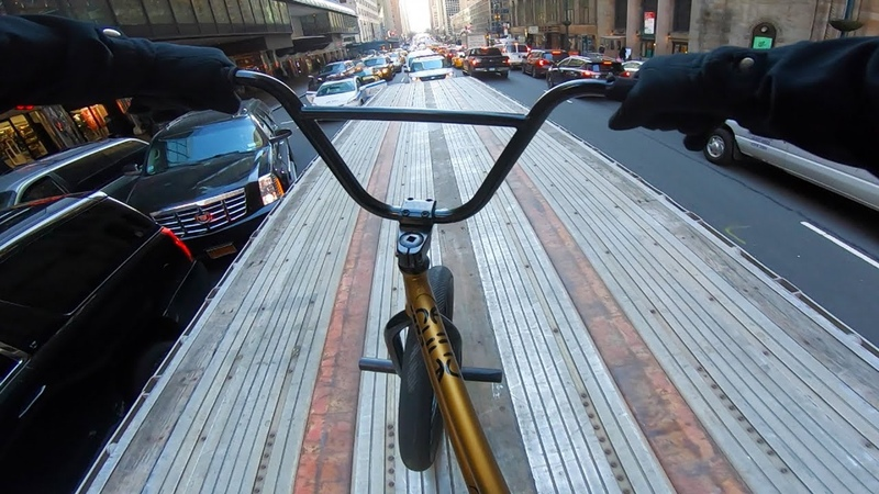 RIDING BMX ON TOP OF MOVING 18 WHEELERS IN NYC