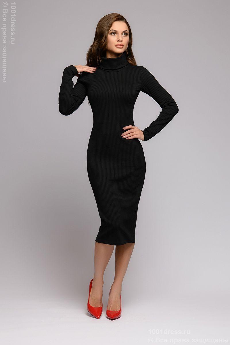 Универсальное платье-бадлон черного цвета с длинными рукавами.